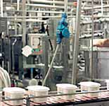 Decontactor provides overhead connection for production line.